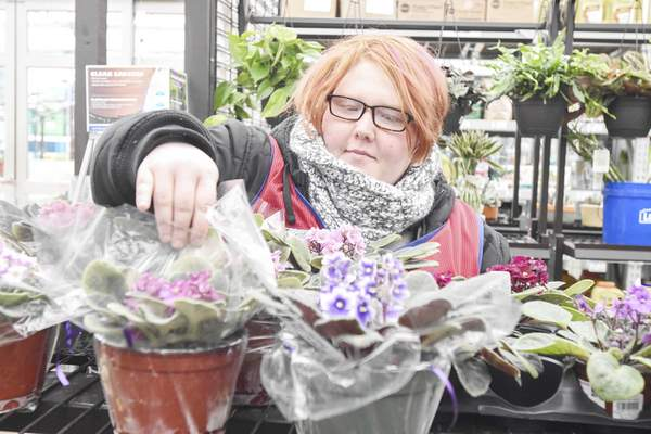 Michelle Davies   The Journal Gazette Shelby Mealer, an employee at Lowe's Home Improvement, in the gardening department, who obtained her job with help from Easterseals Arc.