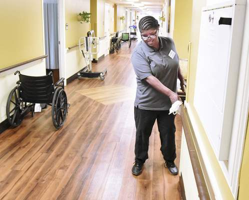 Cathie Rowand   The Journal Gazette Lisa Dobynes, who got her job as a housekeeper with help from Easterseals Arc, cleans at Miller's Merry Manor, 5544 E. State Blvd.