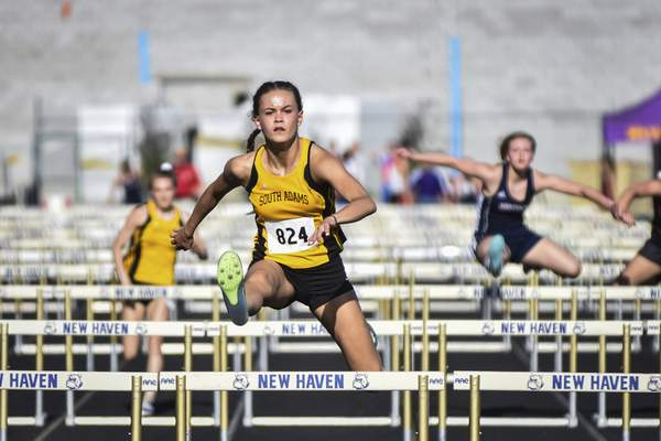 Mike Moore | The Journal Gazette  South Adams senior Addie Wanner runs the hurdles during the ACAC Trackand Field championships at New Haven on Tuesday.