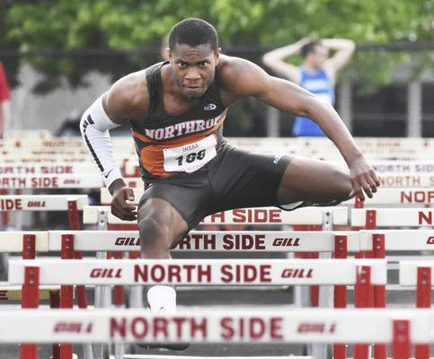 Rachel Von | The Journal Gazette  Northrop's Shaton Vaughn clears a hurdle during the 110 meter hurdles at the Boys' Track & Field Sectional at North Side on Thursday.