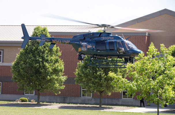 An Indiana State Police helicopter lifts off after a shooting Friday at Noblesville West Middle School in Noblesville. A male student opened fire, wounding another student and a teacher before being taken into custody, authorities said.(Associated Press)