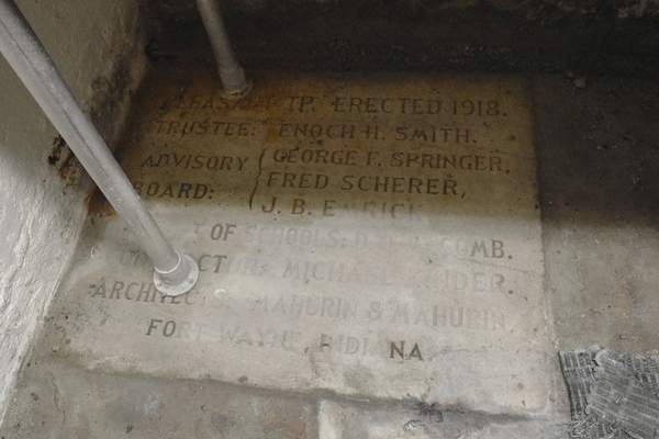 Michelle Davies | The Journal Gazette The cornerstone for Pleasant Township No. 7 is in the basement, featuring names of the builders and architects.