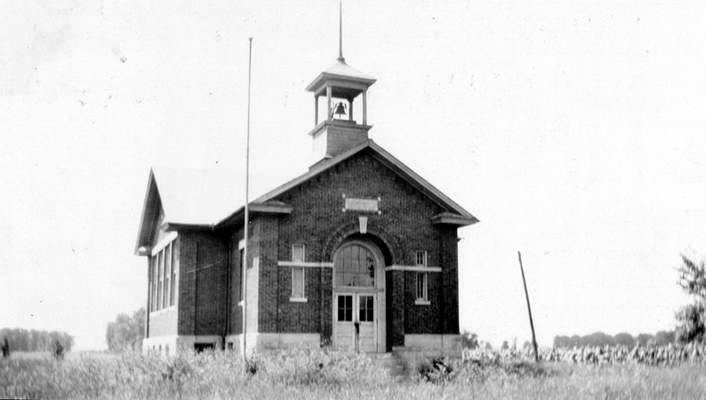 Courtesy The Pleasant Township No. 7 schoolhouse, shown in 1927, celebrates its 100th anniversary this year. Owner Kathy Carrier is planning to name the building after a former teacher.