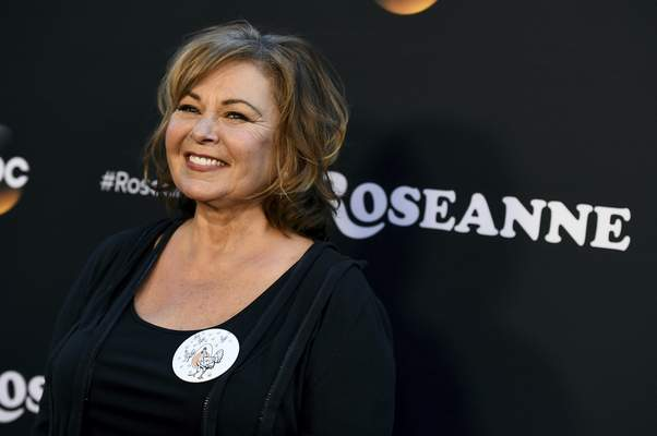 """FILE - In this March 23, 2018, file photo, Roseanne Barr arrives at the Los Angeles premiere of Roseanne on Friday in Burbank, Calif. Barr has apologized for suggesting that former White House adviser Valerie Jarrett is a product of the Muslim Brotherhood and the """"Planet of the Apes.� Barr on Tuesday, May 29, tweeted that she was sorry to Jarrett """"for making a bad joke about her politics and her looks.� Jarrett, who is African-American, advised Barack and Michelle Obama. (Photo by Jordan Strauss/Invision/AP, File)"""