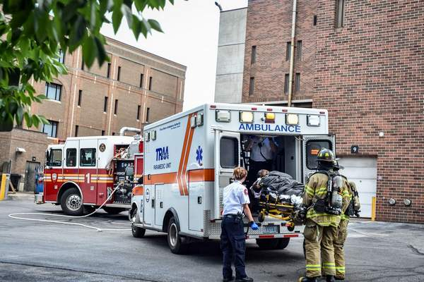 Mike Moore | The Journal Gazette Emergency responders load an unidentified person into the back of an ambulance after a possible exposure to drugs at the Fort Wayne Jail House on Tuesday.