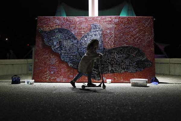 Associated Press A child in Cincinnati plays during last year's Out of the Darkness Walk beside a message board adorned with notes for loved ones who took their own lives. A recent report shows suicide rates have risen in every state except one.