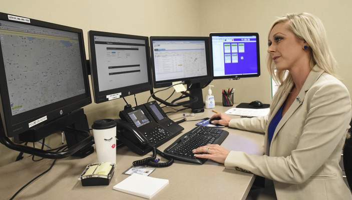 Michelle Davies   The Journal Gazette Lisa Scott, Communication Dispatcher in the Stat Transfer Area at Lutheran Hospital. The area aloows the handling of patients in any hospital in the Lutheran Health Network.