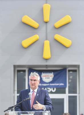 Gov. Eric Holcomb speaks Wednesday at the ribbon-cutting ceremony for the new Walmart milk processing plant. (Michelle Davies | The Journal Gazette)