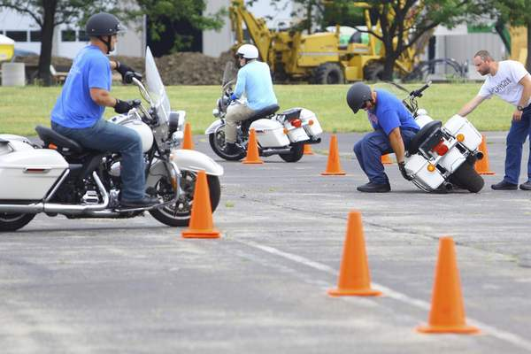 Associated Press Police officers from across the county train to become certified as motor officers this month at the GM parking lot in Kokomo. Damage to the motorcycles is common during the two-week session.