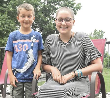 Photos by Michelle Davies | The Journal Gazette Olivia Stoy, 14, plans to undergo a bone marrow transplant next month to fight her cancer. Her donor is her brother Preston, left, a perfect match. The two are seen at their home in Steuben County.