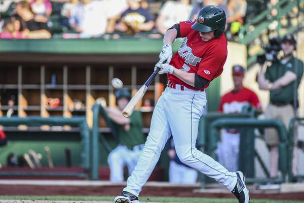 Mike Moore | The Journal Gazette TinCaps right fielder Jack Suwinski connects for a two-run triple in the second inning Monday against Bowling Green.