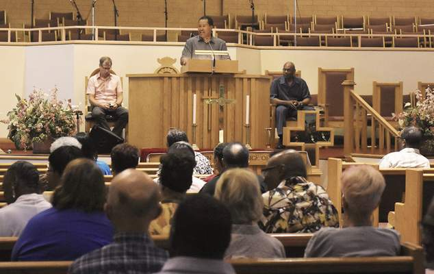 Pastor Raymond C. Dix Jr. speaks during a Community Prayer Service at Pilgrim Baptist Church of Fort Wayne put on by pastors to encourage the violence to stop on Thursday July 5, 2018. In the past week, three people were shot and killed in one night, and another man was found dead in an alley.