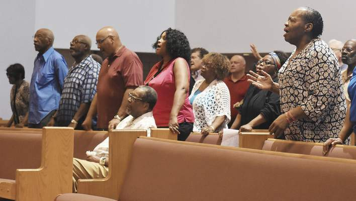 People sing during a Community Prayer Service at Pilgrim Baptist Church of Fort Wayne put on by pastors to encourage the violence to stop on Thursday July 5, 2018. In the past week, three people were shot and killed in one night, and another man was found dead in an alley.