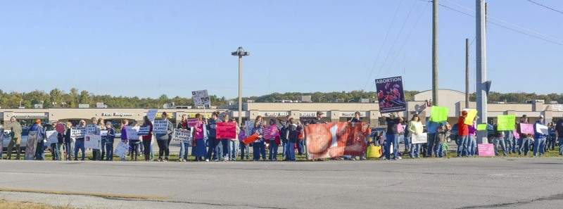 File Around 200 protesters lined West Jefferson Boulevard in front of Planned Parenthood on a Saturday morning in 2015 as part of the second National Day of Protest at Planned Parenthood facilities.