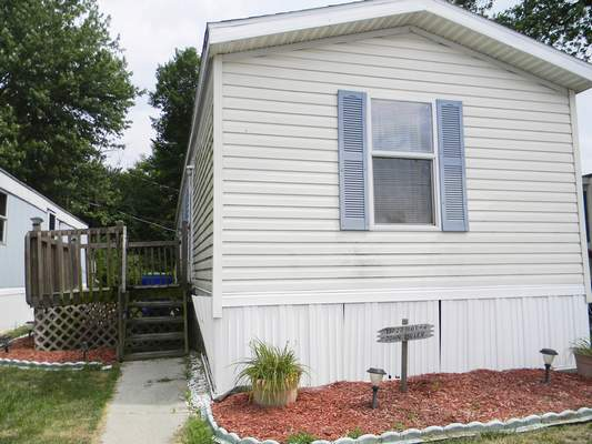 Ashley Sloboda | The Journal Gazette John D. Miller's mobile home on Main Street in Grabill drew police officers Sunday after DNA testing linked Miller, 59, to the sexual assault and strangling of April Tinsley in Fort Wayne 30 years ago.