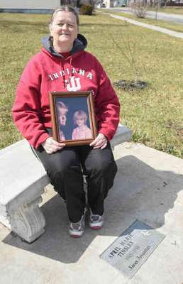 Michelle Davies | The Journal Gazette: Janet Tinsley, the mother of April Tinsley, asked for privacy during a news conference at April's memorial garden on Wednesday.