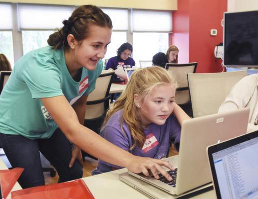 Michelle Davies | The Journal Gazette Hayley Grisez, a senior at Concordia Lutheran High School, works with Kaeli Christian, 12, on her project during The IT Girls camp. The camp, designed by Grisez, introduces robotics, Java programming and Magic Mirror with a Raspberry Pi to girls in grades 7-8.
