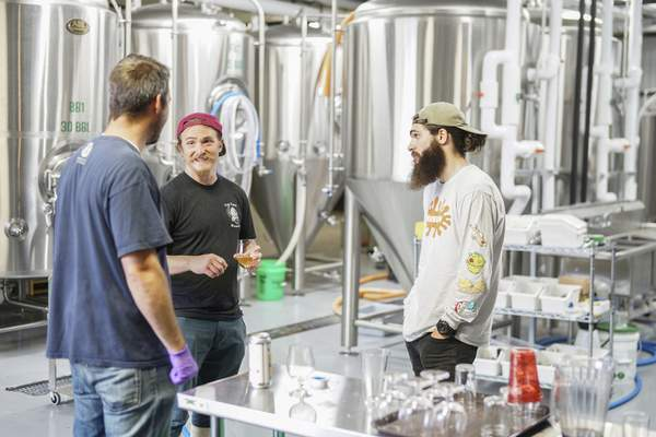 Mike Moore | The Journal Gazette Brewmasters from around Indiana converged on Hop River Brewing Company on Tuesday to craft a  beer during  the Northern Indiana Beer Trail Collaboration Brew Day at the North Harrison Street facility.