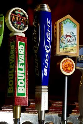 A tap for Anheuser-Busch InBev Bud Light beer sits between taps for a wheat beer from Boulevard Brewing Co., based in Kansas City, Missouri, left, and Fat Tire beer from New Belgium Brewing Co., based in Fort Collins, Colorado, at Llywelyn's Pub in St. Louis, Missouri, on Nov. 9, 2010. MUST CREDIT: Whitney Curtis/Bloomberg