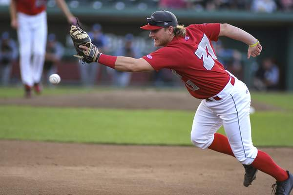 Mike Moore   The Journal Gazette TinCaps first baseman Nick Feight lunges for a line drive hit by West Michigan second baseman Kody Clemens in the first inning  Monday.