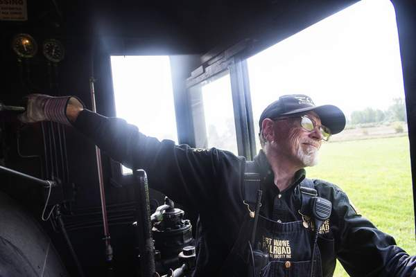 Brett Luke | The Journal Gazette  John Jaress looks out his window as he puts the restored Jeddo Coal No. 85 steam engine into reverse with a lever Saturday afternoon at the Railroad Historical Society for their annual open house weekend.