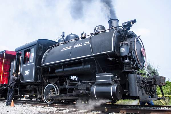 Brett Luke | The Journal Gazette  The restored Jeddo Coal No. 85 steam engine prepares to take a caboose down the track and back during Saturday's annual open house weekend at the Historical Railroad Society.