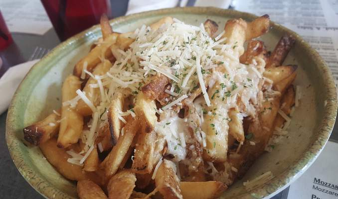 Parmesan garlic fries from Monument Pizza Pub in Angola.