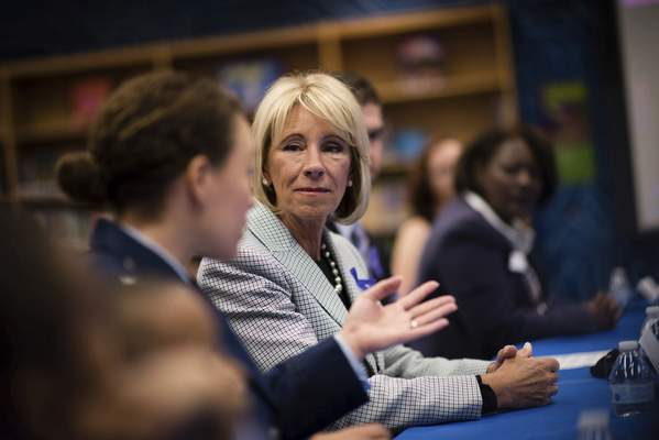 Associated Press Education Secretary Betsy DeVos is considering allowing schools to buy guns with grants.
