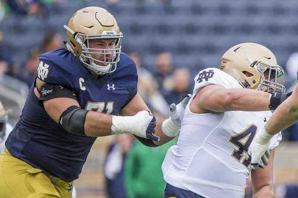 Associated Press Notre Dame guard Alex Bars (71), shown in the spring Blue-Gold Game, will have the support of his brother Blake Bars, a former Michigan Wolverine, when the two teams meet Saturday night at Notre Dame Stadium.