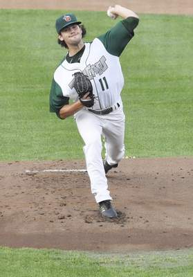 Rachel Von | The Journal Gazette  The TinCaps' Tom Cosgrove pitchesin the first inning against the Captains at Parkview Field on Wednesday.