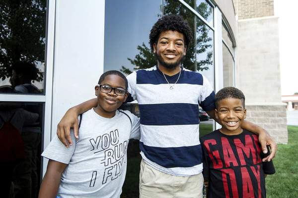 From left, Billie Robinson, 11, Robert Ward, 19, and Jordan Dickey, 9, all have one thing in common – they suffer from sickle cell disease. (Mike Moore | The Journal Gazette)