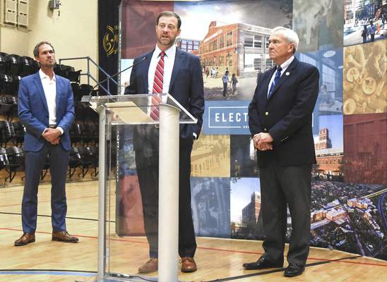 Josh Parker with RTM Ventures answers questions on the Electric Works project with Mayor Tom Henry and Kevan Biggs of Biggs Development looking on Thursday afternoon at the GE campus.( Photos by Michelle Davies | The Journal Gazette)