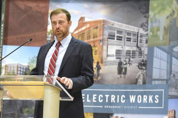 Josh Parker of Cross Street Partners, which is part of Electric Works developer RTM Ventures, addresses the assembled crowd at the GE Club Thursday to announce the finalization of an economic development agreement with the city of Fort Wayne to redevelop the former General Electric site south of downtown.