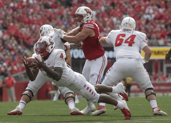 New Mexico's Sheriron Jones grabs a loose snap during the first half of an NCAA college football game against Wisconsin Saturday, Sept. 8, 2018, in Madison, Wis. (AP Photo/Morry Gash)