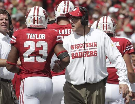 Wisconsin head coach Paul Chryst congratulates Jonathan Taylor after his touchdown run during the second half of an NCAA college football game against New Mexico Saturday, Sept. 8, 2018, in Madison, Wis. Wisconsin won 45-14. (AP Photo/Morry Gash)