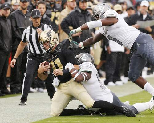 Purdue quarterback David Blough is brought down by the Eastern Michigan defense after a carry in the first half of an NCAA football game Saturday, Sept. 8, 2018, in West Lafayette, Ind. (John Terhune/Journal & Courier via AP)