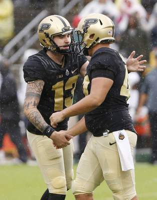 Purdue kicker Spencer Evans, left, is congratulated by teammate Ben Makowski after his field goal against Eastern Michigan in the first quarter of an NCAA football game Saturday, Sept. 8, 2018, in West Lafayette, Ind. (John Terhune/Journal & Courier via AP)