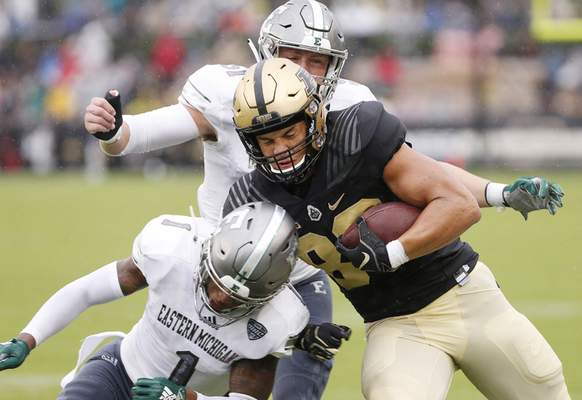 Purdue tight end Brycen Hopkins is brought down by Eastern Michigan's Jalen Phelps (1) and Kyle Rachwal after a pass reception in the first half of an NCAA football game Saturday, Sept. 8, 2018, in West Lafayette, Ind. (John Terhune/Journal & Courier via AP)