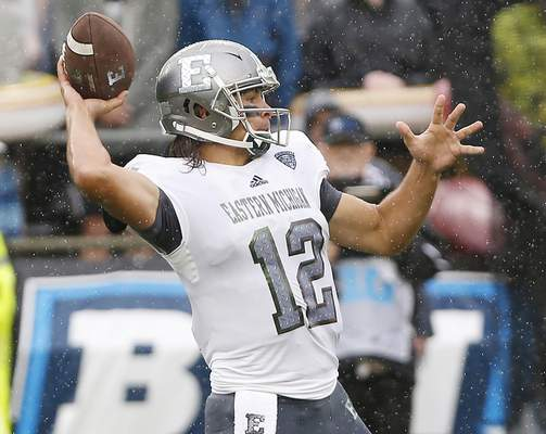 Eastern Michigan quarterback Tyler Wiegers throws a pass against Purdue in the first half of an NCAA football game Saturday, Sept. 8, 2018, in West Lafayette, Ind. (John Terhune/Journal & Courier via AP)