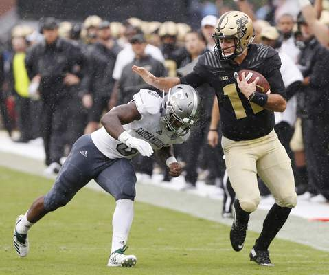 Purdue quarterback David Blough is chased down by Eastern Michigan's Vince Calhoun in the first half of an NCAA football game Saturday, Sept. 8, 2018, in West Lafayette, Ind. (John Terhune/Journal & Courier via AP)