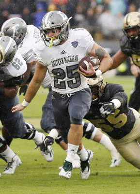 Eastern Michigan's Ian Eriksen carries against Purdue in the first half of an NCAA football game Saturday, Sept. 8, 2018, in West Lafayette, Ind. (John Terhune/Journal & Courier via AP)