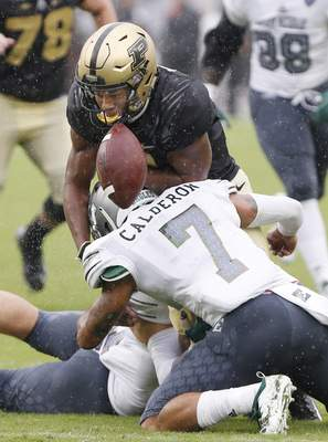 Purdue's Rondale Moore, top, fumbles the ball as he is hit by Eastern Michigan's Ikie Calderon in the first half of an NCAA football game Saturday, Sept. 8, 2018, in West Lafayette, Ind. (John Terhune/Journal & Courier via AP)