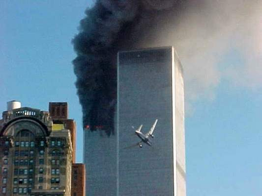 Associated Press: A jet airliner is lined up on one of the World Trade Center towers in New York on Tuesday, Sept. 11, 2001.