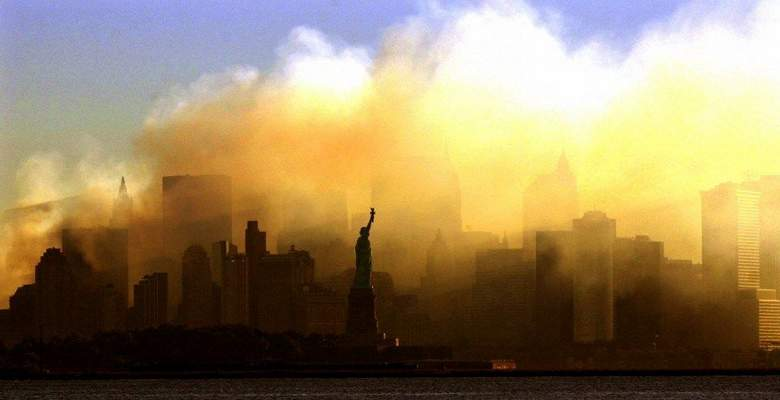 Associated Press: The Statue of Liberty stands out as smoke shrouds Lower Manhattan on Sept. 15, 2001.