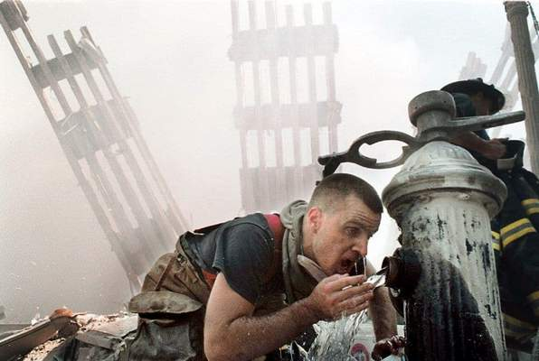Washington Post: U.S. Customs volunteer firefighter Michael Saber drinks water from a fire hydrant in the rubble of the World Trade Center towers.