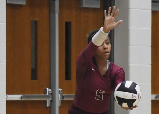 Rachel Von | The Journal Gazette  Concordia's LonDynn Betts serves the ball during the match against Snider at Snider High School on Tuesday.