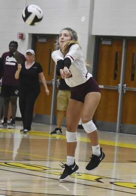 Rachel Von | The Journal Gazette  Concordia's Julia Evans jumps up to hit the ball during the match against Snider at Snider High School on Tuesday. GALLERY