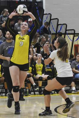 Rachel Von | The Journal Gazette  Snider's Meredith Woolsey, left, hits the ball during the match against Concordia at Snider High School on Tuesday.