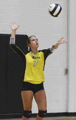 Rachel Von | The Journal Gazette  Snider's Lauryn Wood serves the ball during the match against Concordia at Snider High School on Tuesday.