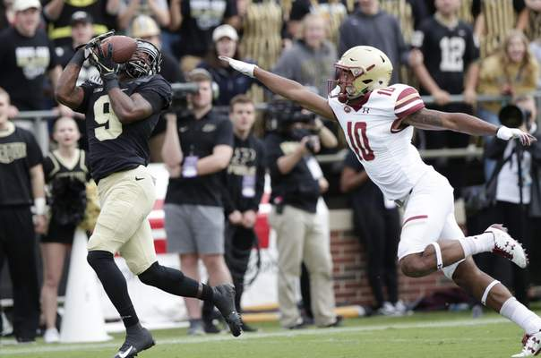 Purdue wide receiver Terry Wright makes a catch for a touchdown in front of Boston College defensive back Brandon Sebastian. (AP Photo/Michael Conroy)